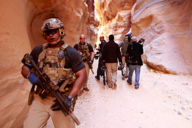Members of the U.S. Secret Service Counter Assault Team survey area during Obama's tour of Petra