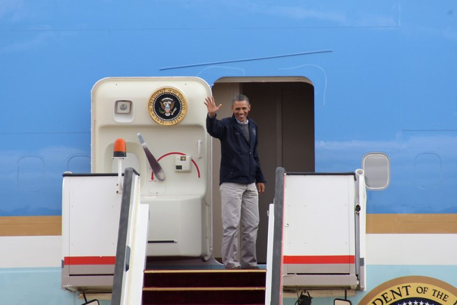U.S. President Barack Obama waves as he boards Air Force One at the airport in Amman