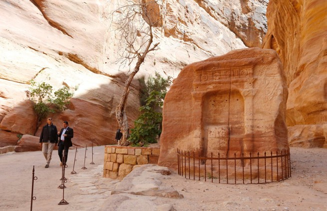 U.S. President Obama walks with Al-Farajat, a tourism professor at the University of Jordan, past an ancient shrine during his walking tour of Petra