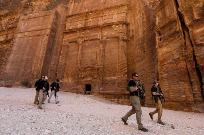 Members of the U.S. Secret Service Counter Assault Team survey a path before U.S. President Obama walks through it during his tour of Petra
