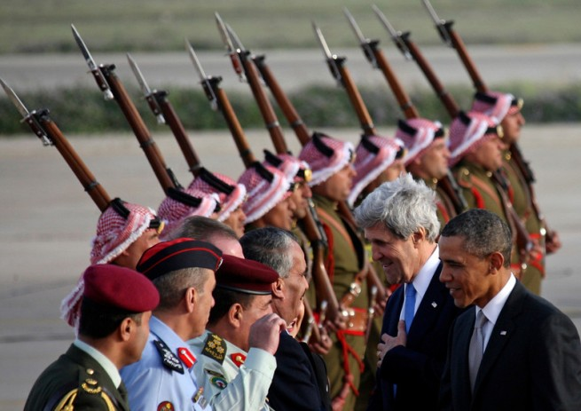 U.S. President Barack Obama and U.S. Secretary of State John Kerry are  greeted by Jordanian officials upon their arrival at Amman airport