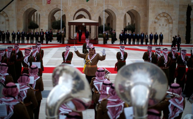 A band plays national anthems as U.S. President Obama participates in an official arrival ceremony with Jordan's King Abdullah II at Al-Hummar Palace, in Amman