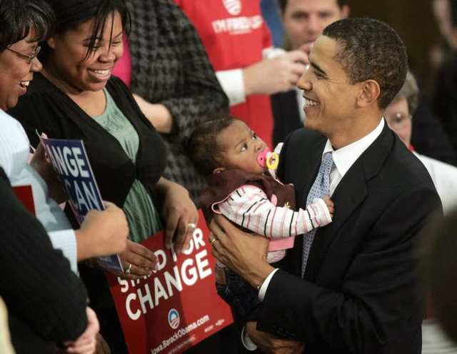 U.S. Democratic presidential candidate Senator Barack Obama (D-IL) holds a supporter's child during a campaign stop in Ft. Madison, Iowa