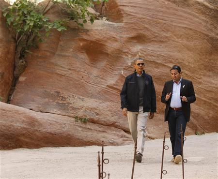 U.S. President Obama participates in a walking tour with Al-Farajat, a tourism professor at the University of Jordan, in Petra