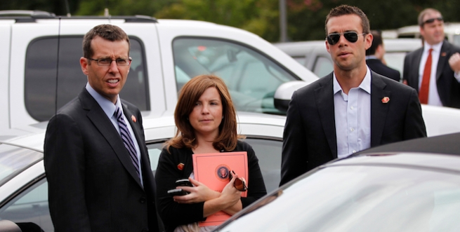 Members of U.S. President Barack Obama's staff Plouffe, Mastromonaco and Favreau are pictured in a parking lot as Obama meets with the spouses of military members in Norfolk