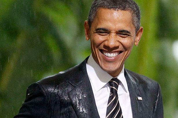 barack-obama-smiles-in-the-rain-pic-ap-560470768