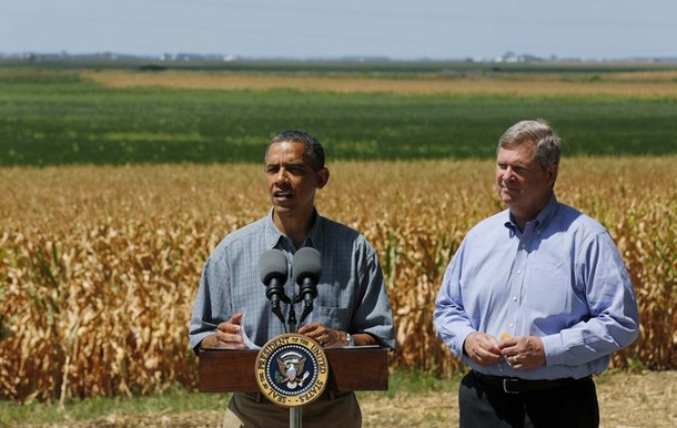 U.S. President Barack Obama talks after he tours a drought ridden corn farm in Missouri Valley, Iowa