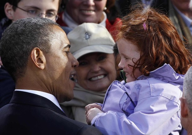 U.S. President Barack Obama holds girl after speaking at an Irish celebration at College Green in Dublin