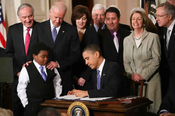obama-signs-obamacare