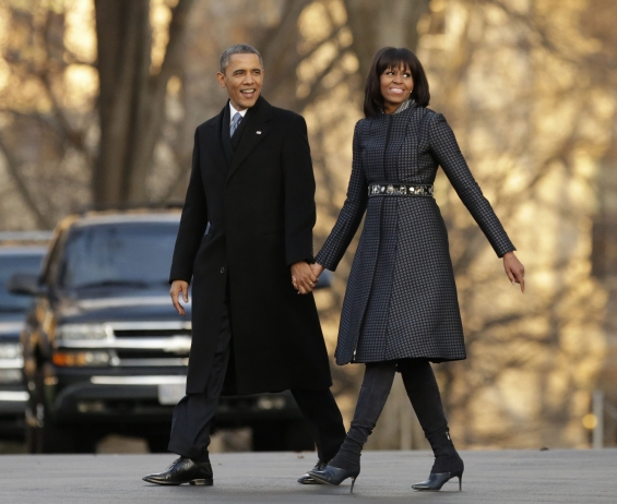 u-s-president-barack-obama-and-first-lady-michelle-obama-walk-from-the-white-house-to-the-inaugural-parade-reviewing-stand-in-washington-january-21-2013-after-returning-from-the-capitol-for-obamas