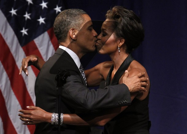 U.S. President Barack Obama kisses first lady Michelle Obama after she introduced him to speak at a fund raiser in New York