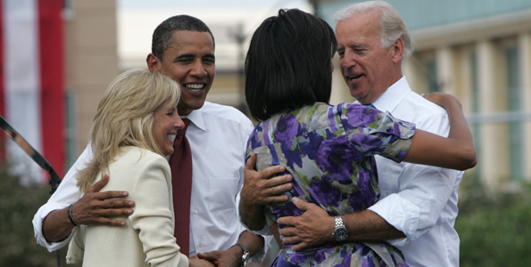 US Democratic presidential candidate Obama and vice presidential running mate Biden greet each others' wives at campaign event at Old State Capitol in Springfield