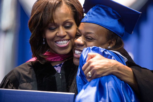 first-lady-michelle-obama-hands-a-diploma-to-a-graduating-senior-during-the-martin-602x401