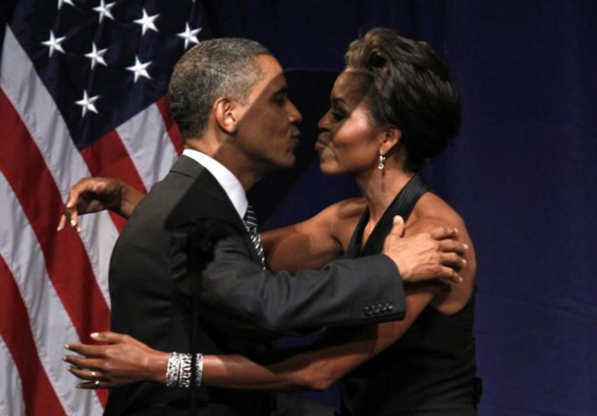163188-u-s-president-barack-obama-kisses-first-lady-michelle-obama-after-she-