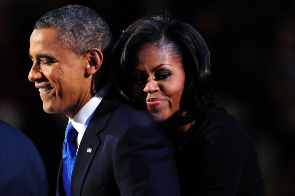 Barack-Obama-is-embraced-by-First-Lady-Michelle-Obama-onstage-after-winning-the-2012-US-presidential-election-in-Chicago-on-November-7-2012.-Robyn-BeckAFPGetty-Images-960x638