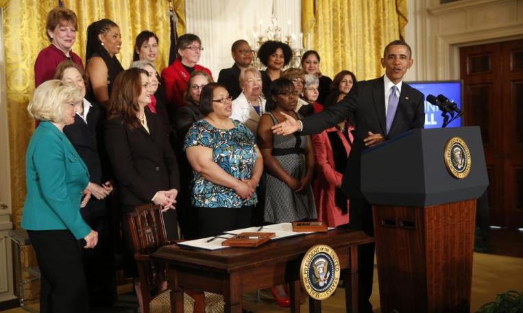 2014-04-08T171831Z_1018655448_GM1EA4903JO01_RTRMADP_3_OBAMA-WOMEN