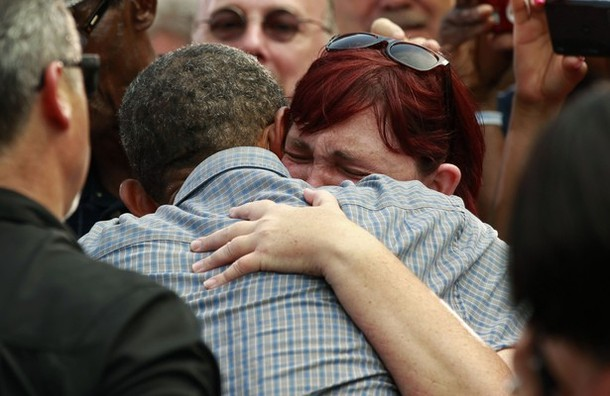 Stephanie Miller cries on the shoulder of U.S. President Barack Obama at a campaign event in Sandusky, Ohio