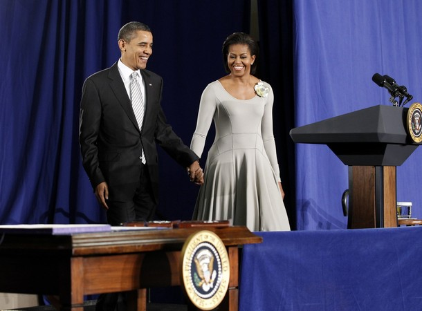 U.S. President Barack Obama and First lady Michelle Obama arrive for the signing of the Healthy, Hunger-Free Kids Act of 2010 in Washington