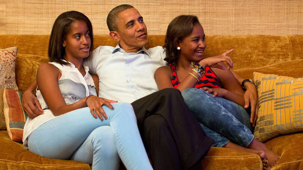 U.S. President Barack Obama and daughters Malia and Sasha, watch on television as first lady Michelle Obama takes the stage to deliver her speech at the Democratic National Convention, in the Treaty Room of the White House in Washington
