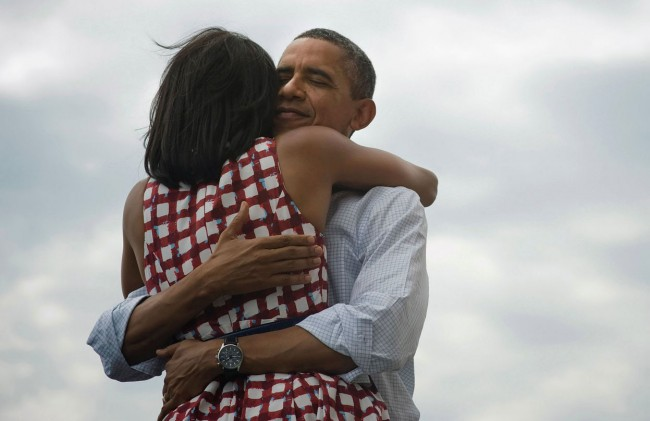 President-Barack-Obama-hugs-his-wife-Michelle-after-she-introduces-him-at-a-campaign-event-at-the-Village-of-East-Davenport-in-Davenport-Iowa-on-August-15-2012.-In-November-this-image-was-attached-to-a-short-message-sent-b