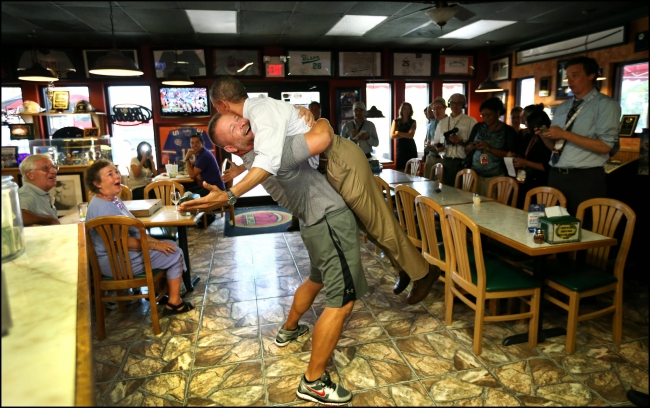 obama-picked-up-by-pizza-shop-owner