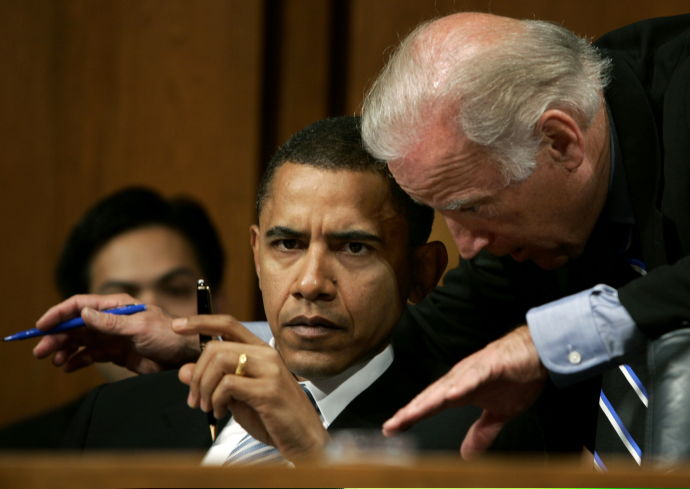 Senators Biden and Obama discuss the nomination of Bolton at a hearing in Washington
