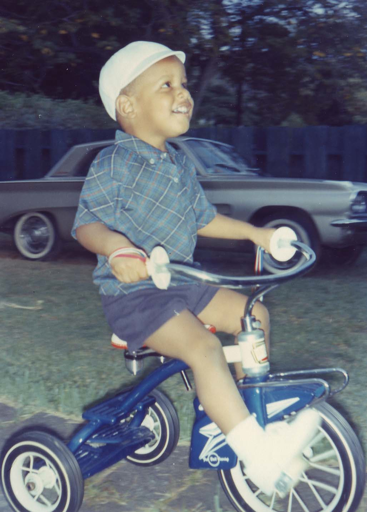 A young Barack Obama on a tricycle in Hawaii in the 1960s.