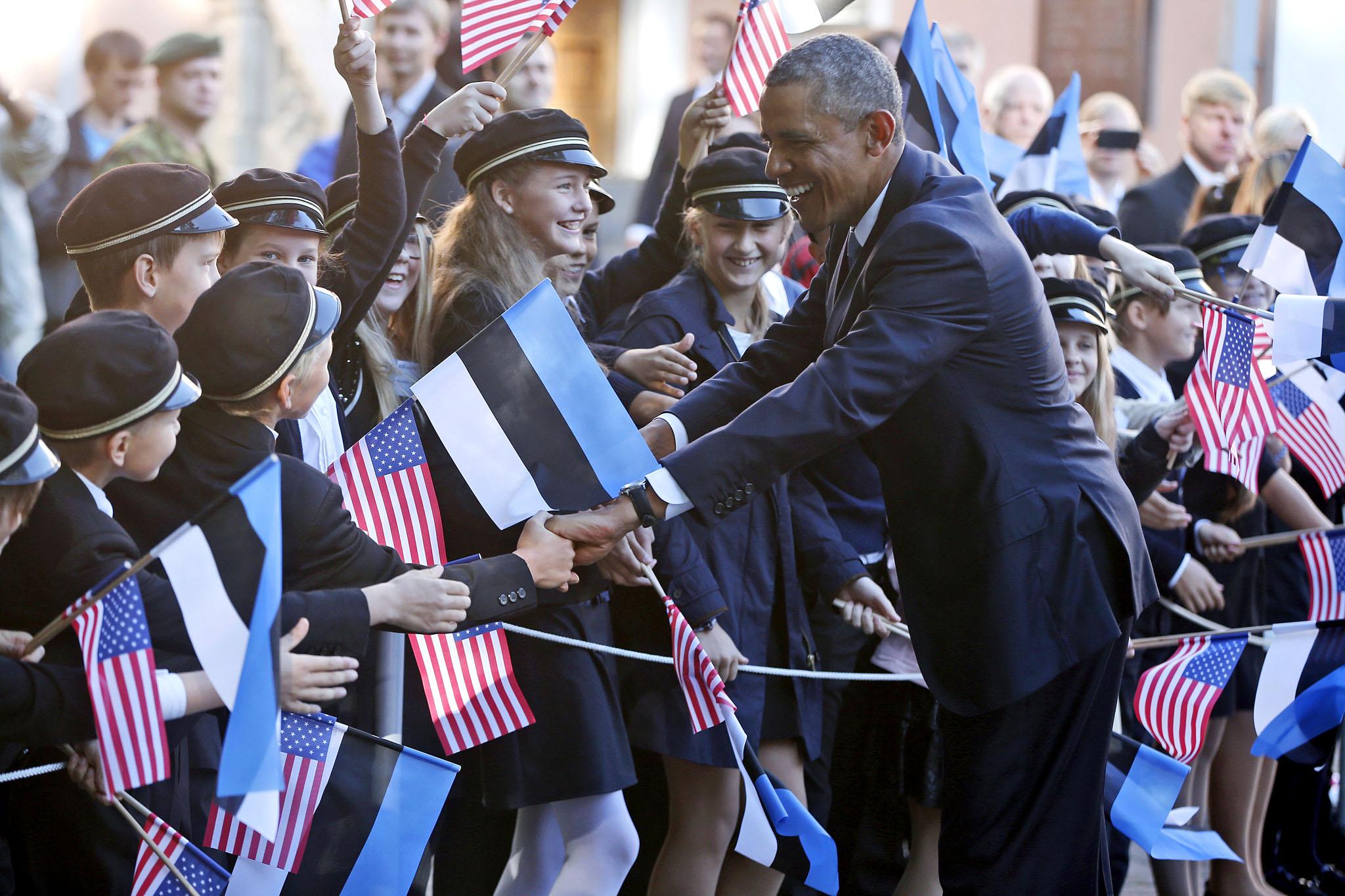 https://obamadiary.files.wordpress.com/2014/12/obama.jpg&#8221