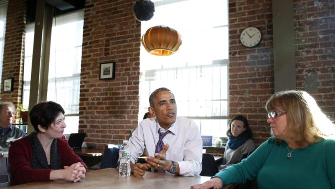 U.S. President Barack Obama talks about legislation to offer paid sick leave for Americans while at Charmington's Cafe in Baltimore