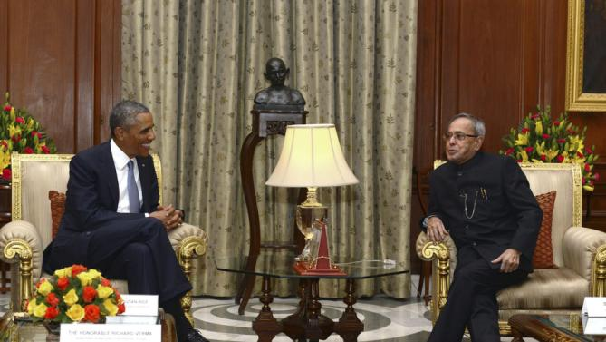 U.S. President Barack Obama smiles during a meeting with his Indian counterpart Pranab Mukherjee in New Delhi