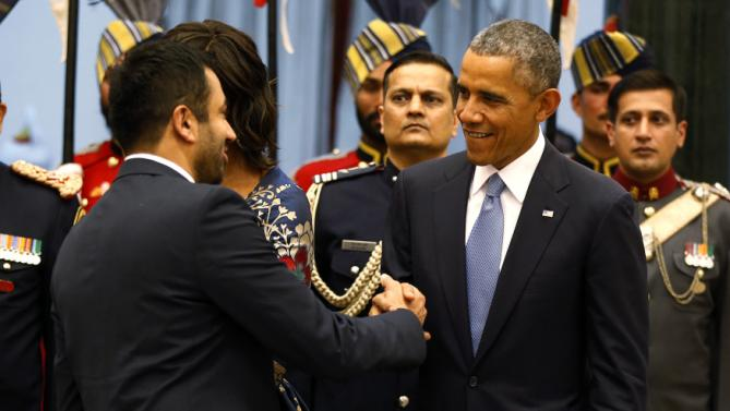 U.S. President Obama talks with Kal Penn as Obama participates in a receiving line before a State Dinner at the Rashtrapati Bhavan presidential palace in New Delhi