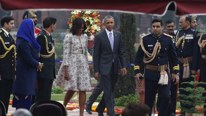 U.S. President Obama and the first lady arrive to attend a home reception with several hundred Indian political and cultural figures at the Rashtrapati Bhavan presidential palace in New Delhi