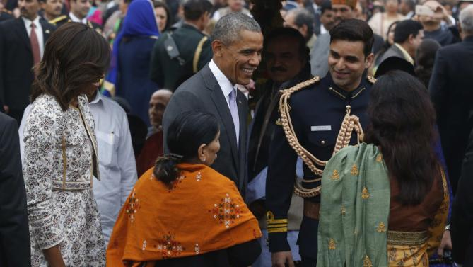 U.S. President Obama and the first lady greet guests at a home reception with several hundred Indian political and cultural figures at the Rashtrapati Bhavan presidential palace in New Delhi