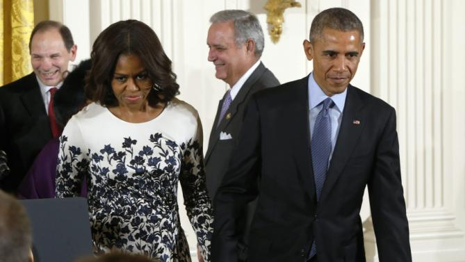 Obama and the first lady depart after a signing ceremony for the the Clay Hunt Suicide Prevention for American Veterans Act into law at the White House in Washington
