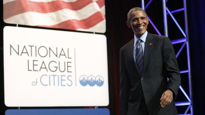 Obama arrives to deliver remarks at the National League of Cities annual Congressional City Conference in Washington