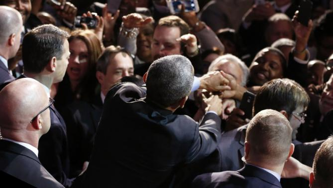 Obama greets attendees after delivering remarks at the National League of Cities annual Congressional City Conference in Washington