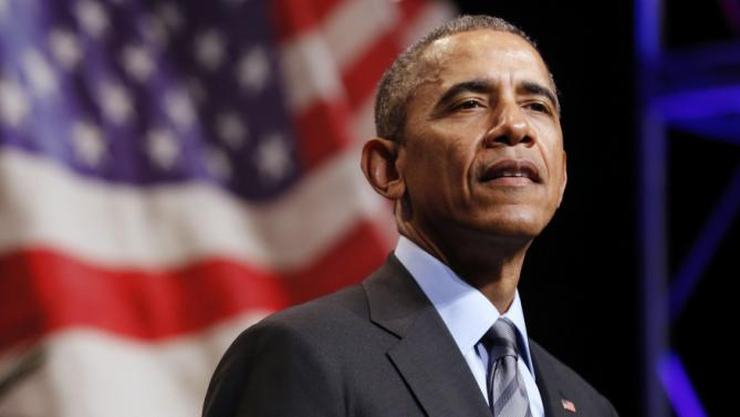 Obama pauses as he makes remarks at the National League of Cities annual Congressional City Conference in Washington