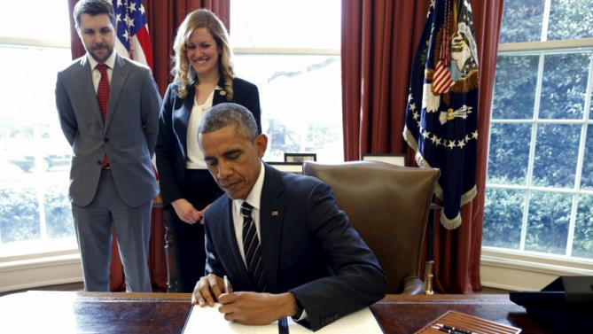 Obama signs greenhouse gas executive order in Washington