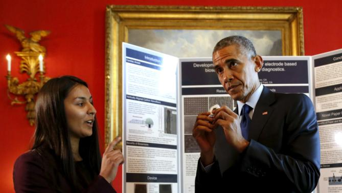 Obama speaks with Pandya about her nanotechnology project as Obama plays host to the 2015 White House Science Fair at the White House in Washington