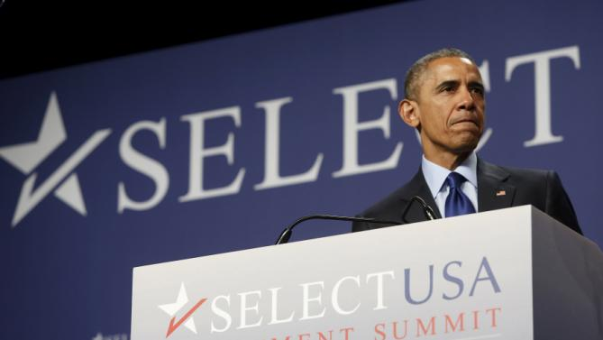 Obama pauses during remarks at the SelectUSA Investment Summit in National Harbor, Maryland