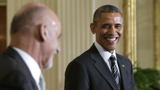 U.S. President Obama reacts to comment by Afghanistan President Ghani during joint news conference at the White House in Washington