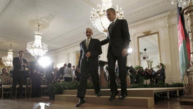 U.S. President Obama and Afghanistan President Ghani depart a joint news conference at the White House in Washington