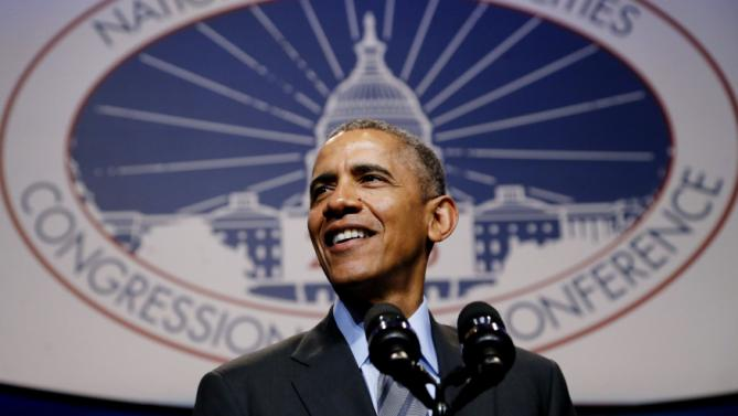Obama delivers remarks at the National League of Cities annual Congressional City Conference in Washington