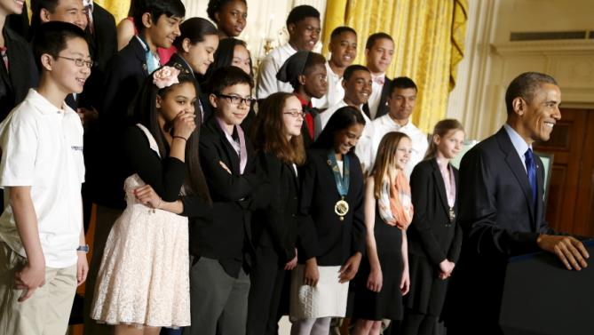 Students laugh at a joke by Obama as he delivers remarks for the 2015 White House Science Fair at the White House