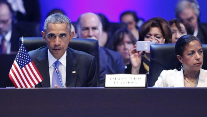 Obama, flanked by Rice, pauses during remarks at the first plenary session of the Summit of the Americas in Panama City, Panama