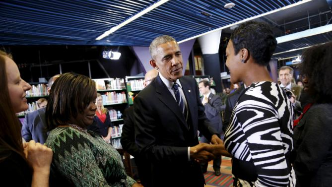 Obama greets attendees after a town hall meeting about working families issues at the ImaginOn educational center in Charlotte, North Carolina