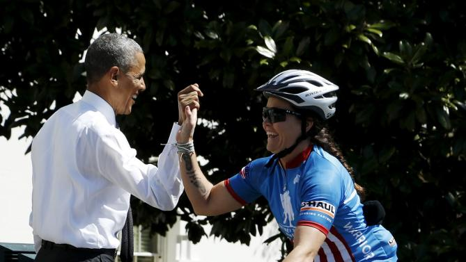 Obama cheers on participants in Wounded Warrior Project's Soldier Ride as they begin 3-day ride to raise awareness for injured veterans at White House in Washington