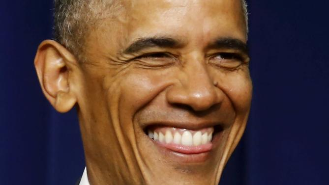 Obama smiles as he takes stage to deliver remarks at  'Champions of Change' event to highlight middle class economic issues on the White House campus in Washington