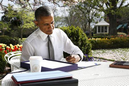 Obama signs the bill H.R. 2 Medicare Access and CHIP Reauthorization Act of 2015, the so-called Medicare 'doc fix,' in the Rose Garden at the White House in Washington