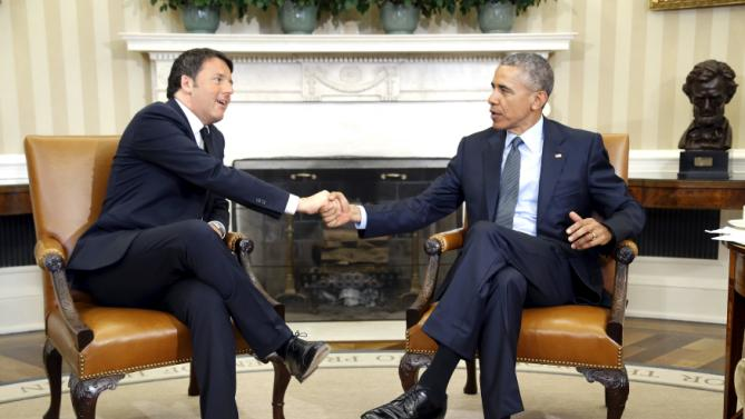 Obama welcomes Renzi before their meeting in the Oval Office at the White House in Washington
